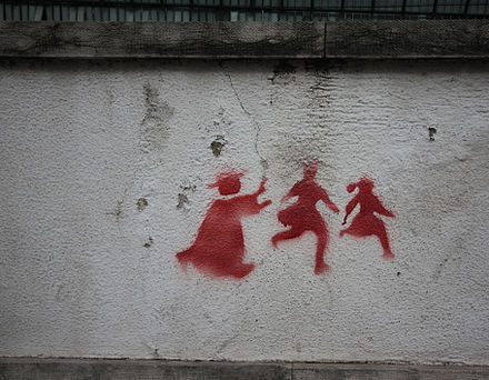 2011 graffiti in Portugal depicting a priest chasing two children. CatholicChurchAbuseScandalGraffitiPortugal2011.JPG