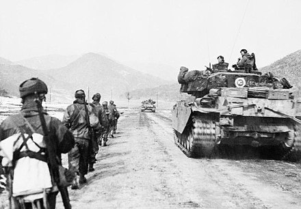 British UN troops advance alongside a Centurion tank, March 1951 Centurion tanks and infantry of the Gloucestershire Regiment advancing to attack Hill 327 in Korea, March 1951. BF454.jpg