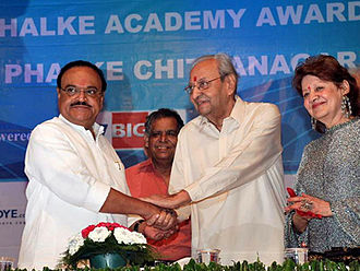Pran (actor) - Pran being felicitated by the then Deputy Chief Minister of Maharashtra Chhagan Bhujbal (left) at the Dadasaheb Phalke Academy Awards in 2010.