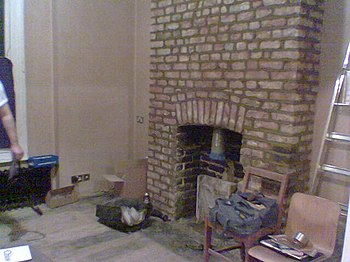 The chimney breast repointed.