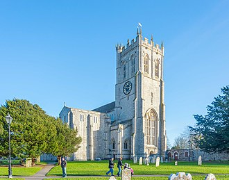 Christchurch, Dorset - Christchurch Priory, the longest Parish Church in the UK, seen from its extensive churchyard.