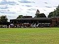 Church Times Cricket Cup final 2019, pavilion spectators 2.jpg