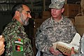 Col. Mir tells U.S. Army Brig. Gen. John McGuiness about the quality of the new boots (4782335385).jpg
