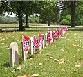 Confederate cemetery tombstone flags.jpg