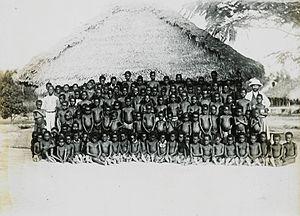 Congo-Balolo Mission - Congo Balolo Mission missionary and village boys (c. 1910).