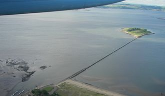 Tidal island - Cramond Island, Scotland, at high tide: the causeway is submerged, but the anti-boat pylons are still visible.