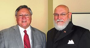 Louisiana Association of Business and Industry - Dan Juneau (left) with retired educator Dr David Ramsey during Juneau's 2012 visit to the Hammond Chamber of Commerce. Juneau explained LABI's positions on various education issues to be considered by the Louisiana Legislature.