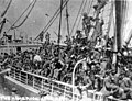 Deck of ship crowded with passengers headed for Nome, June 1906 (AL+CA 1036).jpg
