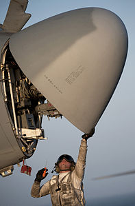 Defense.gov News Photo 110326-N-DR144-077 - Petty Officer 3rd Class Andre Estrada assigned to Electronic Attack Squadron 134 inspects the radar of an EA-6B Prowler aboard the flight deck of.jpg
