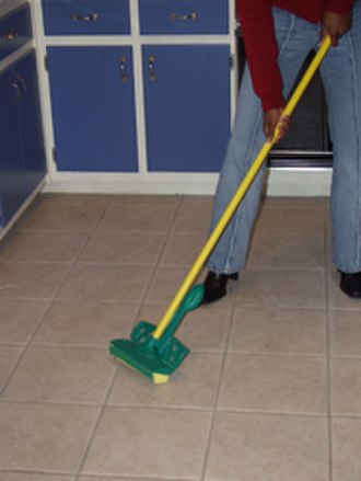 Disinfectant - Disinfection of a floor using disinfectant liquid applied using a mop.