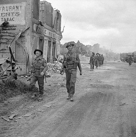 Officer, NCO and men of 'A' Company, 6th Durham Light Infantry, 50th Division, in the village of Douet, France, 11 June 1944. Douet 11 June.jpg