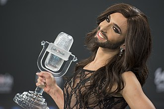 Conchita Wurst - Wurst holding the Eurovision trophy after winning the contest