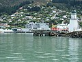 Earthquake damage at Lyttelton harbour, HMNZS Canterbury in background..jpg