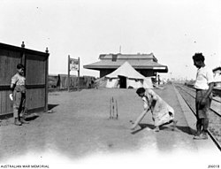 Old photo for children and their father playing cricket at Mit Ghamr Railway station. The father lost his leg whilst working with the Egyptian labour corps in Sinai.