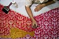 Embellishing the batik (10694536703).jpg