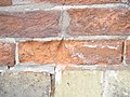 Eroded bricks sw corner of front and frederick, 2013 02 18 -av.JPG - panoramio.jpg
