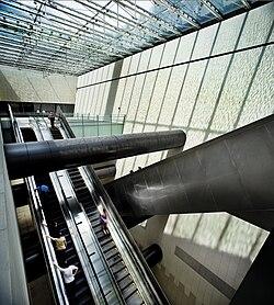 Escalators in Bras Basah MRT Station, Singapore.jpg