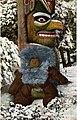 Eskimo child bundled up in winter clothing and resting against base of a totem pole, Alaska, 1909 (AL+CA 1293).jpg