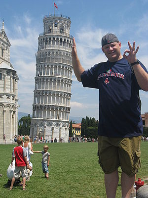 Humour - Forced perspective used for comic effect in front of the Leaning Tower of Pisa