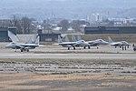 F-15s with a T-4. Komatsu Air Base (47031359364).jpg