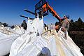 FEMA - 43292 - Lifting sand bags in place in North Dakota.jpg