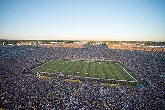 Football Stadium during a game Fans and players gather for a football game Sept. 6, 2014, at Notre Dame Stadium in South Bend, Ind 140906-D-KC128-220.jpg