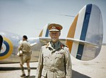 Field Marshal Jan Smuts, Prime Minister of the Union of South Africa, standing in front of SAAF Lockheed Lodestar TR5 aircraft no. 234.jpg