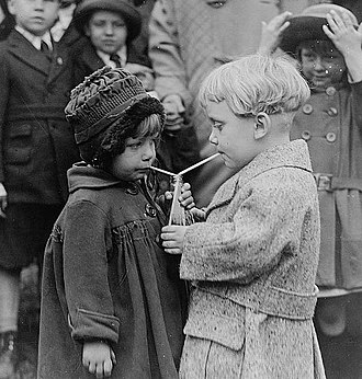Kindness - Two children sharing a soft drink at the White House.