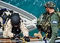 Flickr - Official U.S. Navy Imagery - A Sailor climbs aboard the training ship Aris..jpg