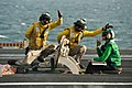 Flickr - Official U.S. Navy Imagery - Sailors signal the launch of an F-A-18F Super Hornet..jpg