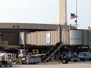 Newark Liberty International Airport - A July 2006 photograph of United Airlines Flight 93's departure gate, A17. Following the 9/11 attacks, American flags flew over the gates of the hijacked flights.