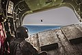 Flight engineer watches from the ramp of a CH-47F Chinook helicopter.jpg