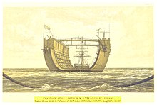 A large, U-shaped vessel, on the high seas, being towed by a sailing ship.