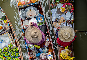 Street food of Thailand - Floating market in Thailand offers a selection of fruits and food.