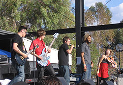 Flobots at KFMA Day in Tucson, Arizona on May 16, 2008. From left to right: Andy Guerrero, Jesse Walker, Jamie Laurie, Stephen Brackett, MacKenzie Gault