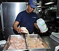 Food preparation aboard the USCGC Mohawk while moored in Guantanamo.jpg