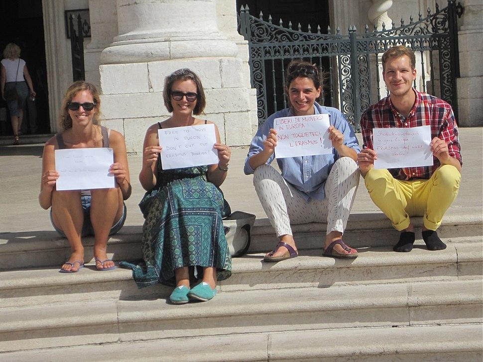 Four students showing placard in Igreja de Santa Engrácia