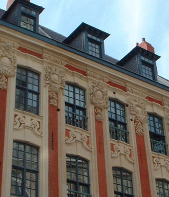Lille - The black dots around the windows (not the decorative cartouches) are Austrian cannonballs lodged in the façade.
