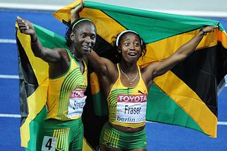 Shelly-Ann Fraser-Pryce - Fraser (right) celebrating victory in Berlin with Kerron Stewart