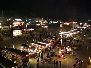 Great Dorset Steam Fair - Night-time view of the line-up of showman's engines, in the fairground (2007).
