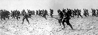 Global financial system - German infantry crossing a battlefield in France in August 1914.
