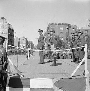 Gordon Holmes Alexander MacMillan - Lieutenant General Brian Horrocks, Major General Gordon McMillan and Major General Charles H. Gerhardt on the saluting base during the ceremony to mark the handover of Bremerhaven by British to American forces.