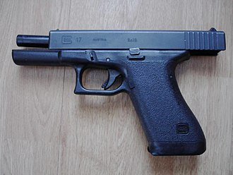 "Glock - A ""first-generation"" Glock 17 with the slide locked back displaying its vertical barrel tilt"