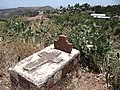 Grave with Town Backdrop - Lalibela - Ethiopia (8725974358).jpg