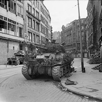 Battle of Hamburg (1945) - A British Sherman Firefly tank in the city centre after the battle.