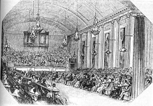 Symphony No. 96 (Haydn) - An engraving from The Illustrated London News, showing a concert in Hanover Square Rooms on Hanover Square. The chandeliers in the hall can clearly be seen.