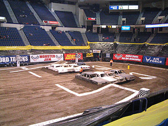 Monster truck - A typical track for arena monster truck shows. The cars have ramps on one side for racing and are left bare on the other side for freestyle. The jumps around the perimeter are for ATV races