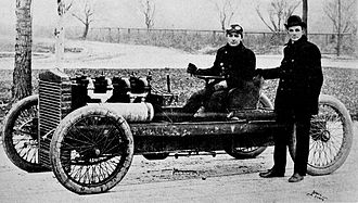 Barney Oldfield - Henry Ford standing next to Oldfield's first car in 1902