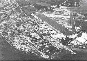 Hickam Air Force Base - Hickam Field, 1940. Pearl Harbor Navy Yard is in the upper left corner and the main barracks is immediately left of the eight hangars in the center.
