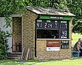 Highgate Cricket Club scorebox scoreboard at Crouch End, Haringey, London, England.jpg